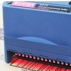Axicon 6515 barcode verifier facing left scanning document