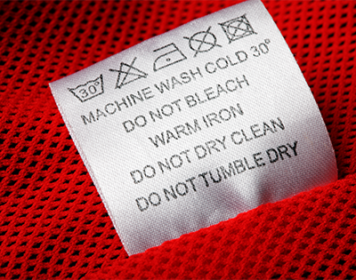 Clothing and textile label button